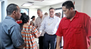 KBE Mayor Anderson Jibas (right) leads the US delegation of Interior Department Assistant Secretary Doug Domenech and Office of Insular Affairs Director Nikolao Pula into the Bikini Town Hall for a meeting last week. Photo: Hilary Hosia.