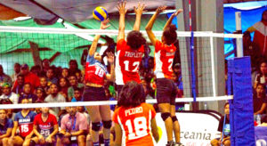 RMI women's volleyball players Sidra Triplett and Aliyah Brown stretch to block a Guam spike, as Rutha Pedro readies to defend. Photo: 9th Micronesian Games Media.