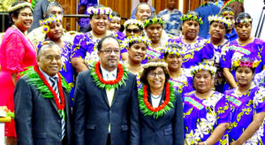 At Nitijela Monday, after the formal opening ceremony, from left: Majuro Iroijlaplap Lein Zedkeia, First Gentleman Tommy Kijiner, Jr. and President Hilda Heine joined the Aur singing group. Photo: Kelly Lorennij.