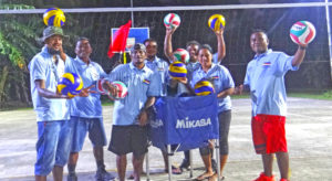 Majuro Day officials pose with donated volleyballs at Jeirok multi-purpose court donated by the Marshall Islands National Olympic Committee. Photo: Belle Jorbelle
