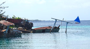 A motorboat carrying five men collided with the superstructure of a sunken vessel (visible in the photo) near the Riwut Corner boat ramp, killing one of the passengers. Photo: Kelly Lorennij.