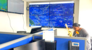 The fisheries surveillance command center at the new MIMRA headquarters features a constantly updated large screen presentation showing the locations of all fishing vessels in the Pacific region. Photo: Giff Johnson.